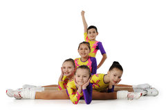 Performance by the young athlete aerobics. On the white background Stock Photo