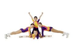 Performance by the young athlete aerobics. On the white background Stock Images