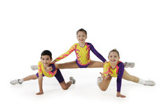 Performance by the young athlete aerobics. On the white background royalty free stock image