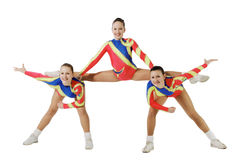 Performance by the young athlete aerobics. On the white background royalty free stock photography