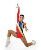 Performance by the young athlete aerobics. On the white background stock photography