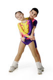Performance by the young athlete aerobics. On the white background royalty free stock photo