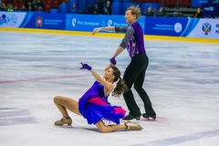 Performance of young men and women in short program Stock Photo