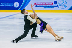 Performances young figure skaters in pair skating short program Stock Photos