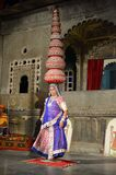 Lady balances pots on her head at Udaipur, Rajasthan, India