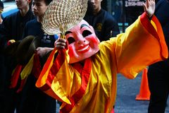 Performer in costume at the Golden Dragon Parade, celebrating the Chinese New Year royalty free stock photography