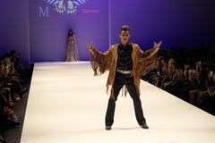 A performer dances on the runway at the Malan Breton fashion show Stock Images