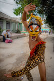 Performer dressed in jaguar skin costume and face. BARRANQUILLA, COLOMBIA - FEBRUARY 18, 2015: Performer dressed in jaguar skin costume and face paint part of Royalty Free Stock Images