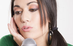 Performer Female Sings Into Microphone Holding Ear Closed Listen Royalty Free Stock Images