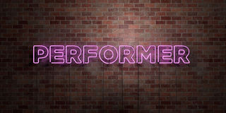 PERFORMER - fluorescent Neon tube Sign on brickwork - Front view - 3D rendered royalty free stock picture Stock Images