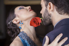 Performer Holding Rose In Mouth While Performing With Partner Royalty Free Stock Images