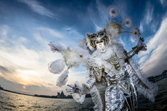 Performer with original and creative costume during venice carnival Stock Photo