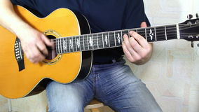 Performer playing on the acoustic guitar. stock video