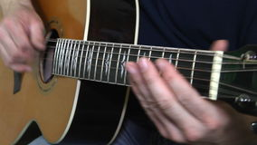 Performer playing on the acoustic guitar stock video footage