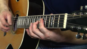 Performer playing on the acoustic guitar. stock footage