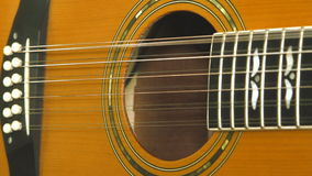 Performer playing on the acoustic guitar. Musical instrument with guitarist hands stock video