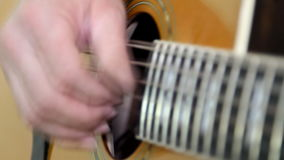 Performer playing on the acoustic guitar. stock video footage