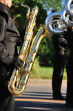 Performer Playing Baritone saxophone in Parade Royalty Free Stock Images