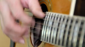 Performer playing on the guitar. stock footage