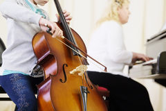 The performer plays  a violoncello Stock Photography