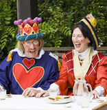 Performer re-enacting the mad hatters tea party. Telford, Shropshire, England. July, 21 2012 : Man and woman dressed as the king and queen of hearts Performing Royalty Free Stock Photo