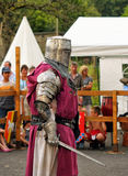 Performer shows medieval costume Royalty Free Stock Photo