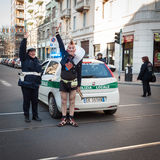 Performer stopping the traffic with police. MILAN, ITALY - MARCH 6: Performer stops the traffic with police at Milan Clown Festival, international event Royalty Free Stock Photography