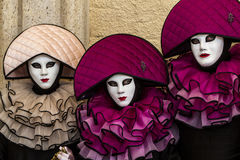 Performers with beautiful costume during venice carnival. Performers with beautiful costume with rustles, amazing moon hat and venetian mask during venice Royalty Free Stock Photography