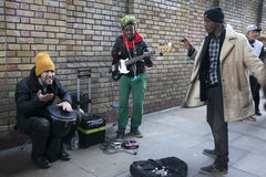 Performers busking at Brick lane on Sunday Royalty Free Stock Image