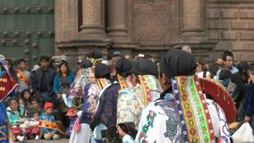 Performers dancing at the cathedral of cusco in peru