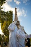 Performers in front of the Eiffel Tower Stock Photo