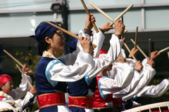 Performers at the Korean Drum Festival, Seoul. A group of South Korean women perform at the Korean Drum Festival, Seoul, South Korea, with their drum sticks Royalty Free Stock Image