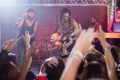 Performers performing at nightclub Stock Photos