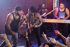 Performers singing at nightclub Stock Photos