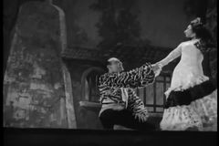 Performers in Spanish costumes dancing on stage stock video footage