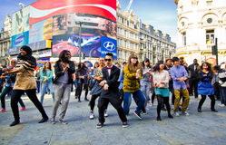 Gangnam Style. Performers street dance London 2012 -young people dancing Gangnam Style on London Piccadilly Circus royalty free stock photo