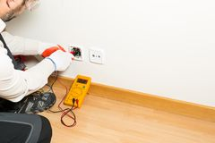 Performing A Repair Electrician Royalty Free Stock Photography