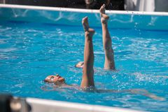 Free Performing Artistic Duet In Swimming Pool: Synchronized Swimming During Exercise Royalty Free Stock Image - 106802106
