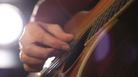 Performing chords on acoustic guitar stock video footage