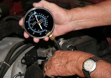 Performing compression test. Performing a compression test on an automobile engine Stock Photo