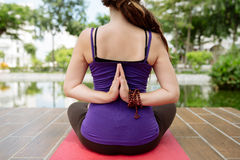 Performing lotus pose Stock Photography