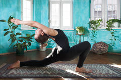 Low lunge yoga pose. Performing a low lunge yoga pose royalty free stock photography