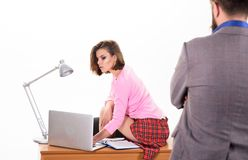 Performing office secretary duties. Boss looking at company secretary working in office. Sexy secretary in office wear. Using laptop. Sensual secretary women stock images