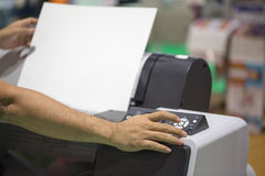 Performing a photocopy clerk with multifunction printer Stock Photos