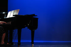 Performing a piano piece on stage Royalty Free Stock Photos