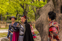 Performing a play dressed in Japanese feudal costumes Stock Image