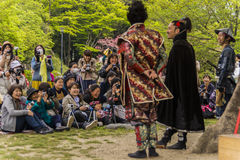 Performing a play dressed in Japanese feudal costumes Royalty Free Stock Image