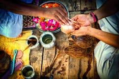 Performing prayer pooja hindu indian way Stock Photography