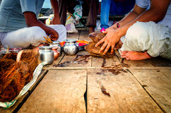 Performing prayer pooja hindu indian way Stock Image