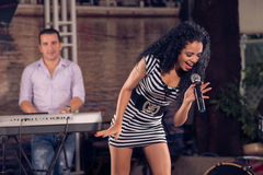 Performing on the stage. Image of an emotional singer performing in the club on the foreground Royalty Free Stock Photo